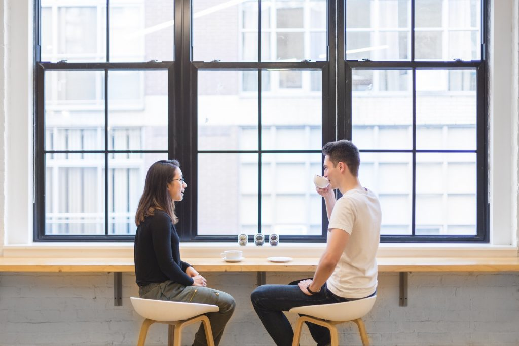 Two people in a cafe